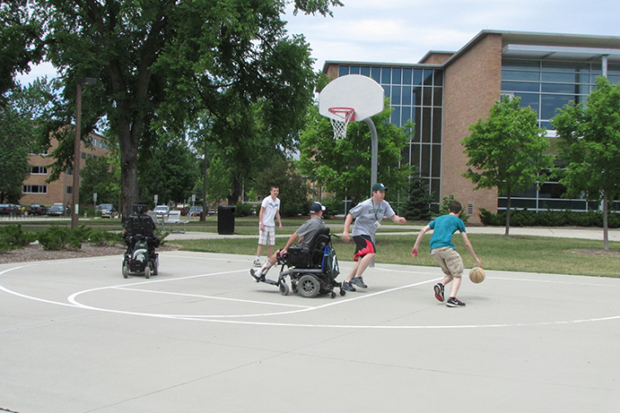 Project Venture students playing basketball, some using wheelchairs