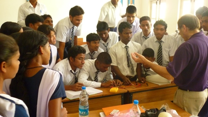 High school students learn from the RCPD about digital electronics and assistive technology in India.